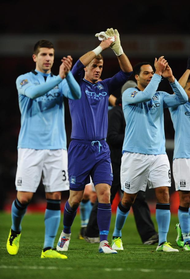 LONDON, ENGLAND - JANUARY 13: (L-R) Matija Nastasic, Joe Hart and Joleon Lescott of Manchester City applaud the travelling fans after the Barclays Premier League match between Arsenal and Manchester City at Emirates Stadium on January 13, 2013 in London, England. (Photo by Mike Hewitt/Getty Images)