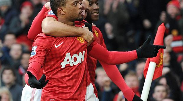 Patrice Evra celebrates in the victory over Liverpool
