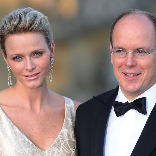 Prince Albert of Monaco and his wife Princess Charlene have accepted damages from Times Newspapers Ltd