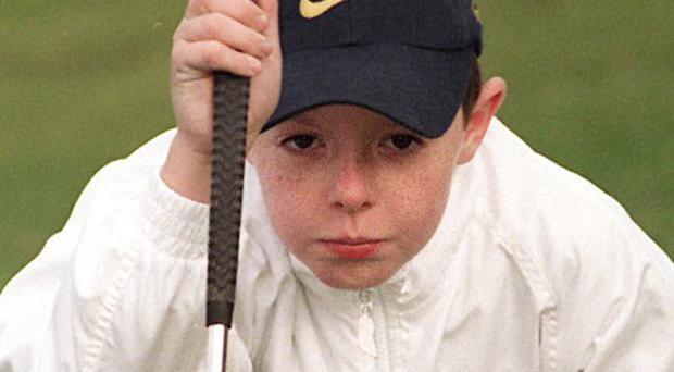 Rory McIlroy sporting a Nike cap aged 7