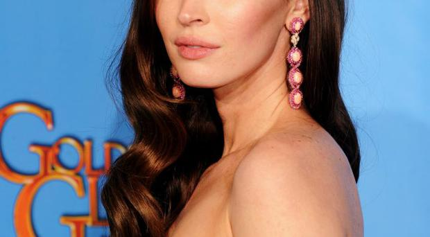 Megan Fox poses in the press room during the 70th Annual Golden Globe Awards