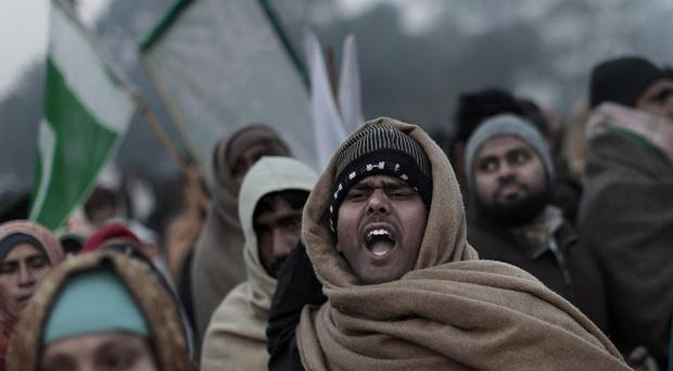 Supporters of Pakistani Sunni Muslim cleric Tahir-ul-Qadri chant anti-government slogans during a rally in Islamabad (AP)