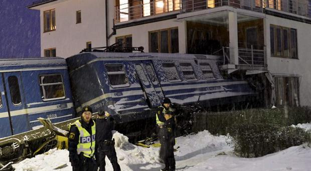 The stolen train lodged in a building (AP)