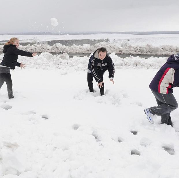 Youngsters throwing snowballs have been warned they could be arrested