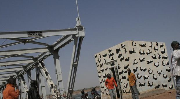 Soldiers man a checkpoint at a bridge in Markala in central Mali (AP)