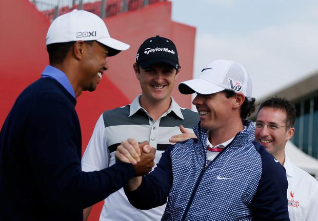 ABU DHABI, UNITED ARAB EMIRATES - JANUARY 15: Tiger Woods of the USA (L) greets Rory McIlroy of Northern Ireland as Justin Rose of England looks on before a photo call prior to the start of the Abu Dhabi HSBC Golf Championship at Abu Dhabi Golf Club on January 15, 2013 in Abu Dhabi, United Arab Emirates. (Photo by Scott Halleran/Getty Images)