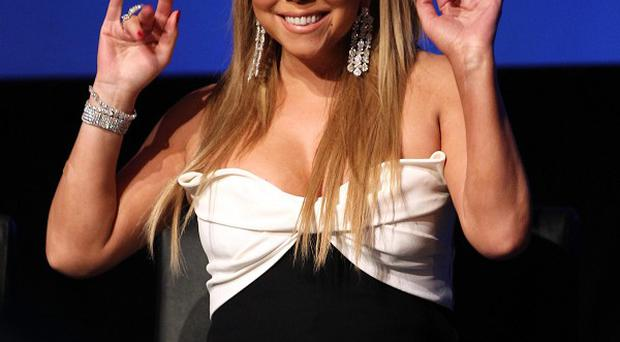 Mariah Carey gets attached to the American Idol contestants
