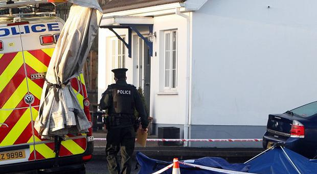 A house in Ballymena where a 64-year-old man was stabbed to death and his wife seriously injured