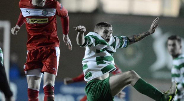 Cliftonville's Marc Smyth and Sean Cleary fight for the ball