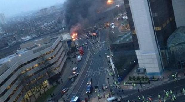 The scene where a helicopter crashed in central London after hitting a crane on top of a tower block by the River Thames (Victor Jimenez/PA)