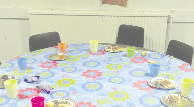 Empty chairs: the table where children were sitting when the hall was struck by missiles