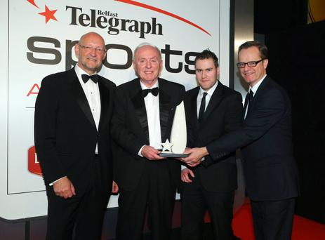 Eddie Harper (second left), from Holywood Golf Club, accepts our Sports Star of the Year award on behalf of Rory McIlroy whose talent as a three-year-old Eddie spotted at the club in his role as Juvenile Convenor. Also pictured (from left) Brian Henning, Sport NI chair, David Lawlor of sponsors Linwoods and Mike Gilson, Editor of the Belfast Telegraph