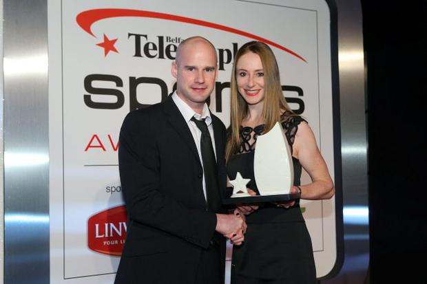 Press Eye - Belfast - Northern Ireland - 14th January 2013 - Belfast Telegraph Sports Awards at the Ramada Hotel4.Player of the Year - Ryan Farquhar Ryan Farquhar receives his award from Wendy Houvenaghel Picture by Kelvin Boyes / Press Eye.