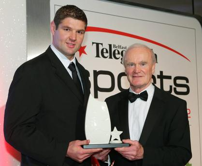 The Ulster rugby team beat off tough competition for our Team of the Year prize,collected by skipper Johann Muller from rugby legend Mike Gibson