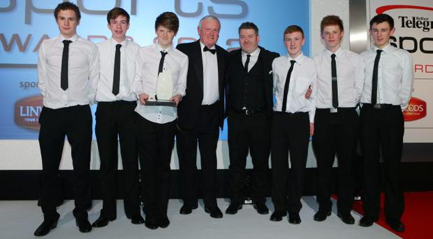 Winning St Oliver Plunkett Under-16 team with coach Stephen Lynch and Alistair Gillespie, sales marketing manager of sponsors Linwoods