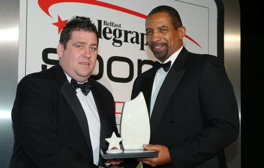 Top boss PJ O'Mullan picks up his award from Ireland cricket coach Phil Simmons