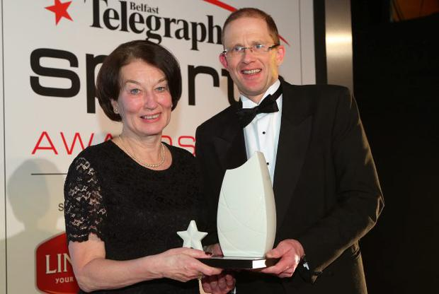 Press Eye - Belfast - Northern Ireland - 14th January 2013 - Belfast Telegraph Sports Awards at the Ramada Hotel3.Local Heroes Award   - Fiona Haldane Fiona Haldane receives her award from Nick Harkness, Sport Northern Ireland Picture by Kelvin Boyes / Press Eye.