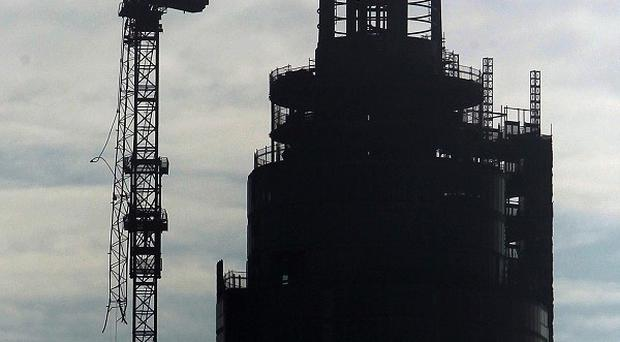 A general view of the damaged crane on top of The Tower close to the scene where a helicopter crashed