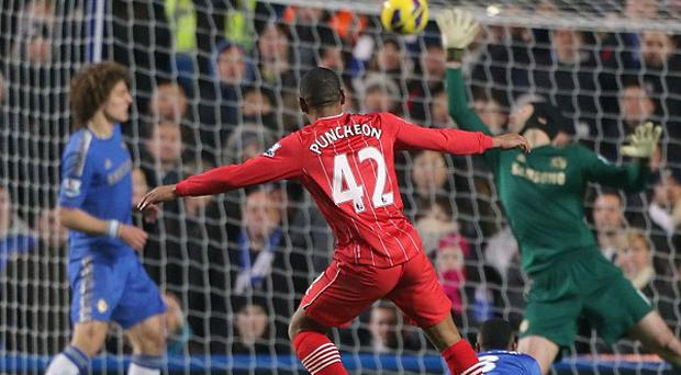 Jason Puncheon, centre, volleys home Southampton's equaliser to earn them a point