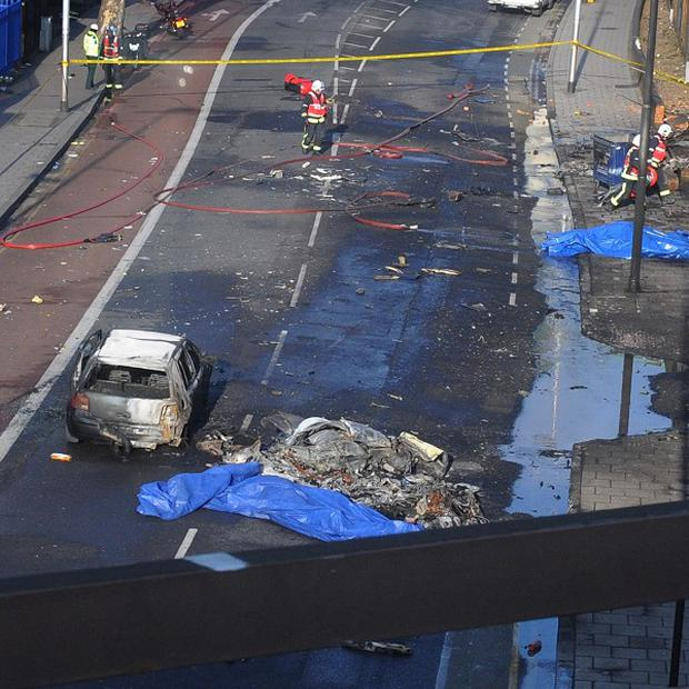 The scene after a helicopter crashed into a construction crane in central London