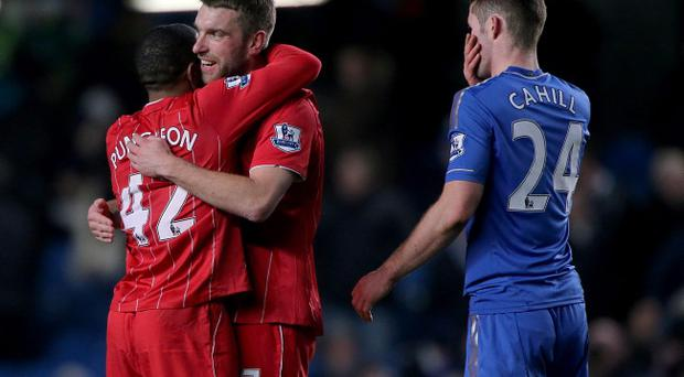 Southampton's Rickie Lambert (centre) and Jason Puncheon (left) celebrate after the final whistle as Chelsea's Gary Cahill (right) looks on during the Barclays Premier League match at Stamford Bridge, London