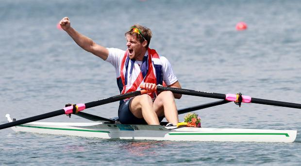 Northern Ireland's Alan Campbell wins a bronze medal in the final of the Mens Single Sculls at Eton Dorney during the 2012 London Olympics