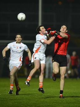 Armagh's Niall Rowland and Conor Gough of Down clash during last night's match in Newry