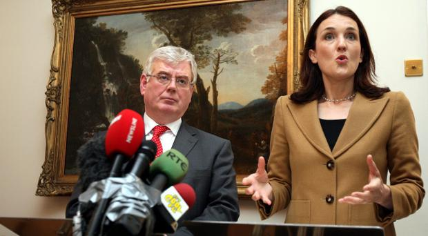 Northern Ireland Secretary,Theresa Villiers with the Irish Foreign Minister, Eamon Gilmore at a press conference at Stormont House, Belfast after they held talks about the Union flag protests