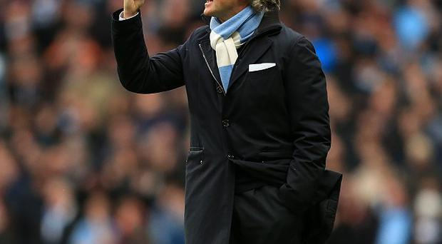 Roberto Mancini will take Manchester City to Asia in the summer