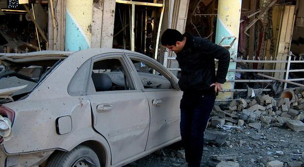 Car bombs and roadside bombs have killed at least 22 people in Iraq (AP)