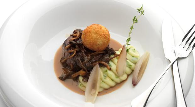 Fillet of beef, champ potato, wild mushrooms, Stilton and oxtail croquette