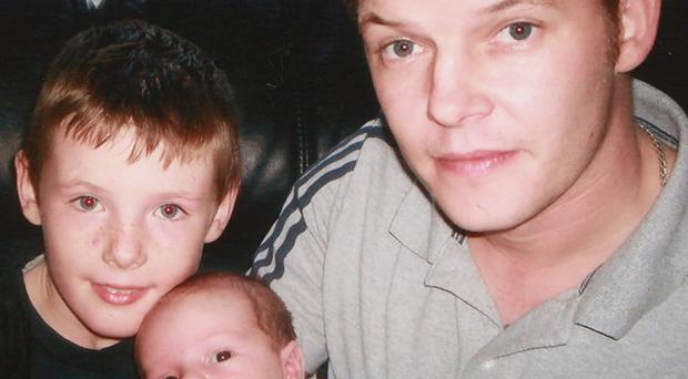 Stephen McFaul with his sons Dylan (left) and Jake