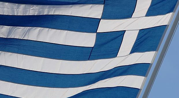 Many Greeks are facing pay cuts during the country's economic crisis