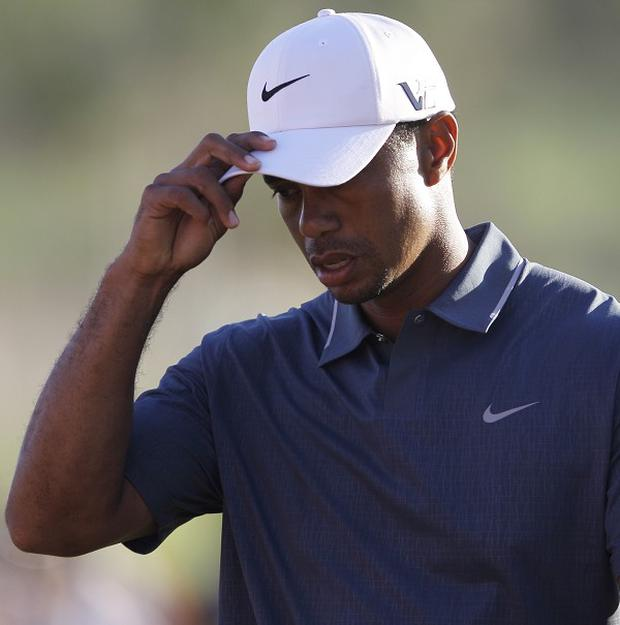 Tiger Woods, pictured, and Rory McIlroy both carded second-round 75s (AP)