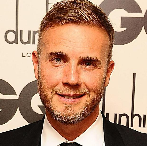 Romatic Gary Barlow serenaded the happy couple on stage