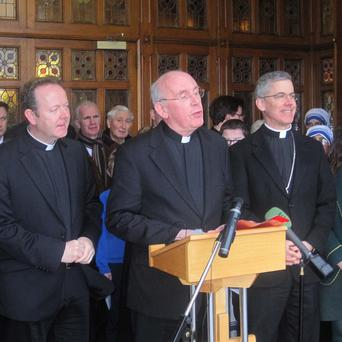 Cardinal Sean Brady (centre) announces his retirement