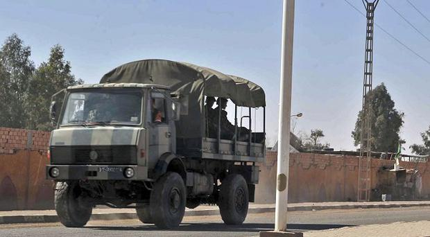 An Algerian army truck is seen in a street of Ain Amenas, near the gas plant where hostages were kidnapped by Islamic militants (AP)