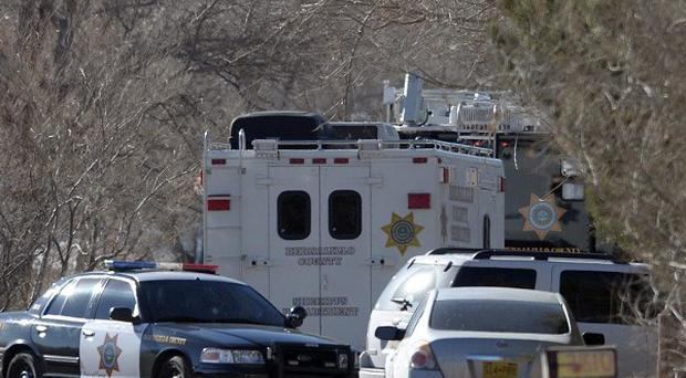 A teenager has shot two adults and three children in a New Mexico home