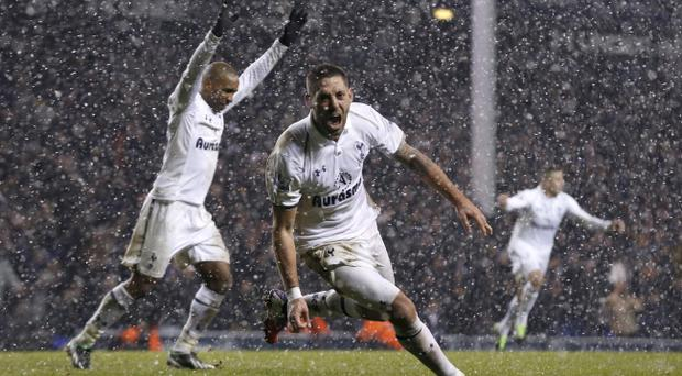 Tottenham Hotspur's Clint Dempsey, centre, celebrates his goal beside Jermain Defoe, left, during the English Premier League soccer match between Tottenham Hotspur and Manchester United at White Hart Lane stadium