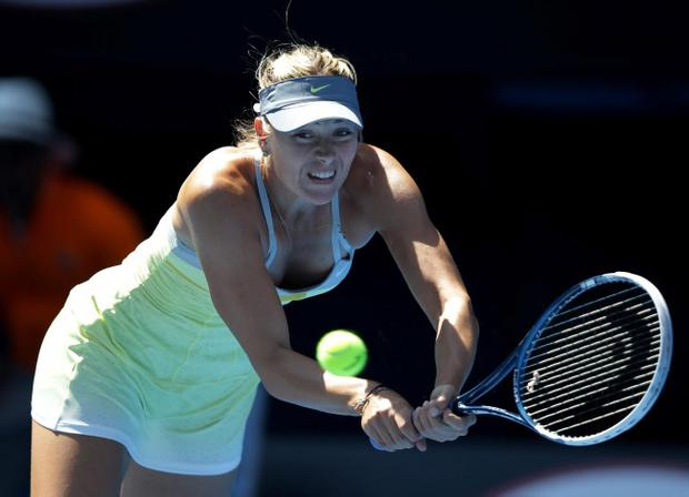 Russia's Maria Sharapova hits a backhand return to Belgium's Kirsten Flipkens during their fourth round match at the Australian Open tennis championship in Melbourne, Australia, Sunday, Jan. 20, 2013. (AP Photo/Dita Alangkara)