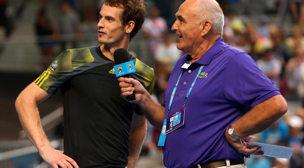 MELBOURNE, AUSTRALIA - JANUARY 21: Andy Murray of Great Britain speaks to commentator Stephen Phillips after winning his fourth round match against Gilles Simon of France during day eight of the 2013 Australian Open at Melbourne Park on January 21, 2013 in Melbourne, Australia. (Photo by Julian Finney/Getty Images)