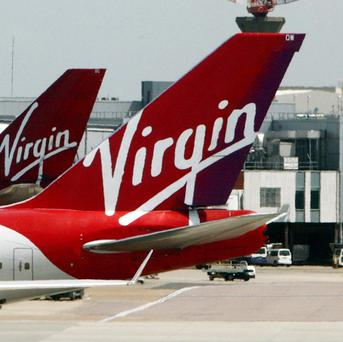 Virgin Atlantic will give first class passengers the chance to buy paintings during the flight