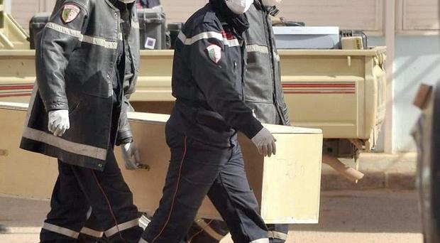 Algerian firemen carry a coffin containing the body of a person killed during the hostage situation in Ain Amenas (AP)