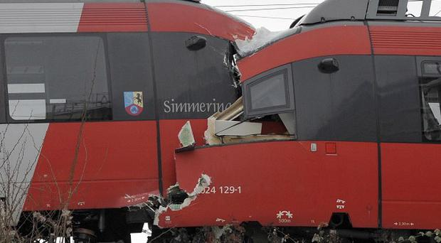 The driver's cabins are seen destroyed after two regional trains crashed head on in Vienna, Austria (AP Photo/dapd, Hans Punz)
