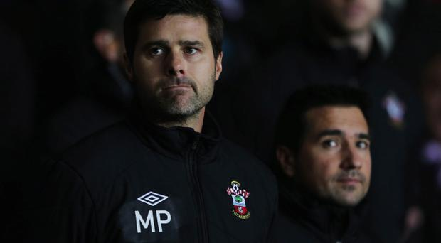 SOUTHAMPTON, ENGLAND - JANUARY 21: Mauricio Pochettino new manager of Southampton looks on prior to the Barclays Premier League match between Southampton and Everton at St Mary's Stadium on January 21, 2013 in Southampton, England. (Photo by Ian Walton/Getty Images)