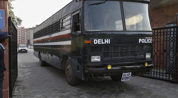 A Delhi police van, believed to be carrying the five men accused of raping and murdering a woman on a bus, leaves a district court in New Delhi (AP)