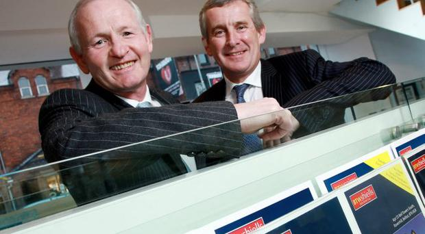 Keith Shiells (left) and Simon Brien celebrate the new merger