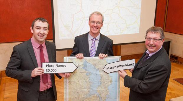 (l-r) Daithi McKay MLA, chair of the Stormont committee for finance and personnel; Dr Michael O Mainnin, Queen's School of Modern Languages; and Sammy Wilson, Minister for Finance and Personnel, at the launch of placenamesni.org