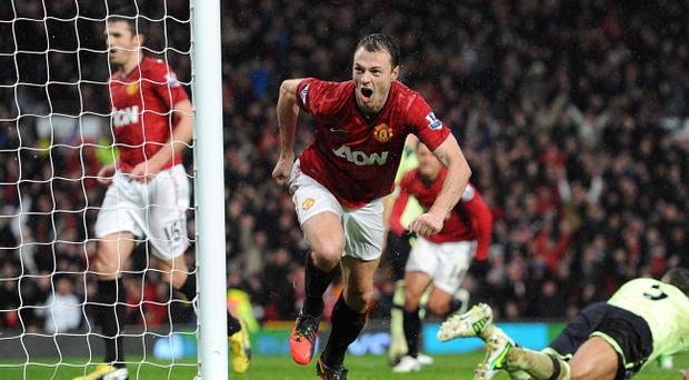 Johnny Evans has been tipped as a future captain of Manchester United after approaching 150 appearances for the club