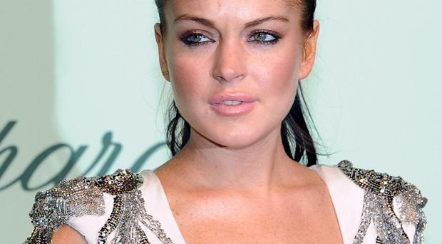 Lindsay Lohan posted a snap of herself pulling faces with Max George
